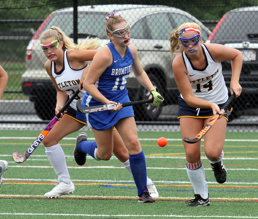 . Littleton vs Bromfield field hockey. Bromfield\'s Ella Corbett (19) and Littleton\'s Amanda Yurkoski (3) and Valerie Crory (14). (SUN/Julia Malakie)