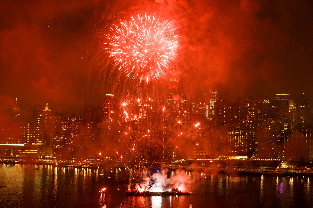 . With the New York City skyline in the background fireworks explode during an Independence Day show over the East River, Wednesday, July 4, 2018, in New York. (AP Photo/Andres Kudacki)