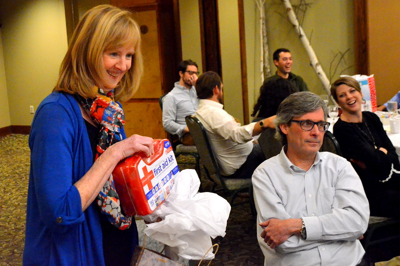 Kathy opens her gift - a first aid kit.