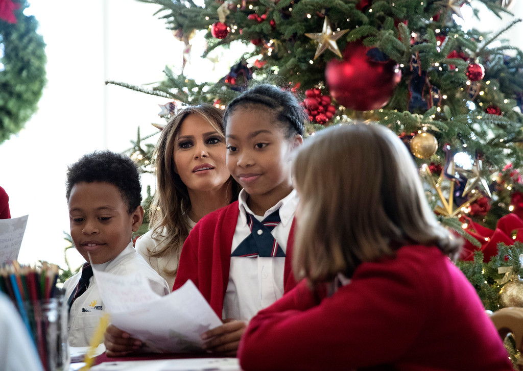 """. First lady Melania Trump visits with Children in the East Wing among the 2017 holiday decorations with the theme \""""Time-Honored Traditions\"""" at the White House in Washington, Monday, Nov. 27, 2017. The First Lady honored 200 years of holiday traditions at the White House. (AP Photo/Carolyn Kaster)"""