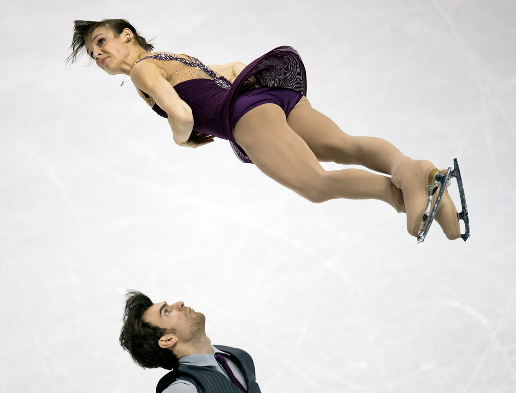 . Meagan Duhamel and Eric Radford of Canada perform their free skate program in the pairs competition at the World Figure Skating Championships Friday, March 15, 2013 in London, Ontario. (AP Photo/The Canadian Press, Frank Gunn)