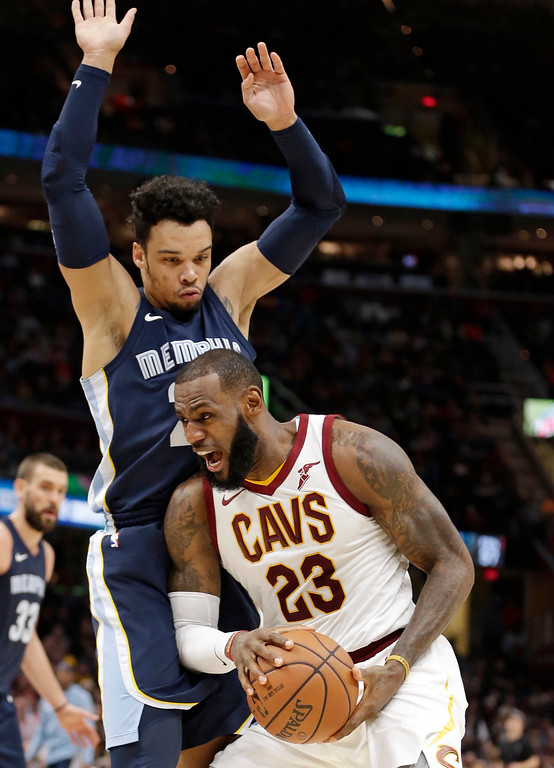 . Cleveland Cavaliers\' LeBron James (23) drives against Memphis Grizzlies\' Dillon Brooks (24) in the first half of an NBA basketball game, Saturday, Dec. 2, 2017, in Cleveland. (AP Photo/Tony Dejak)