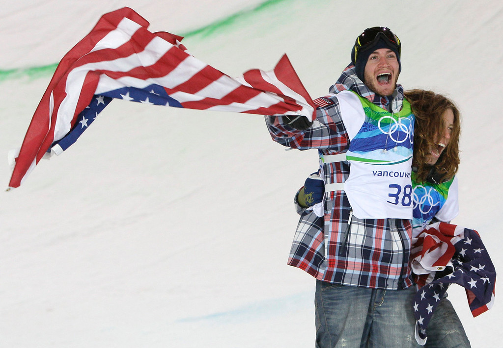 . Olympic champion Shaun White of the USA, right celebrate with teammate and bronze winner Scott Lago of the USA after the  men\'s snowboard halfpipe final at the Vancouver 2010 Olympics in Vancouver, British Columbia, Wednesday, Feb. 17, 2010. (AP Photo/Gerry Broome)