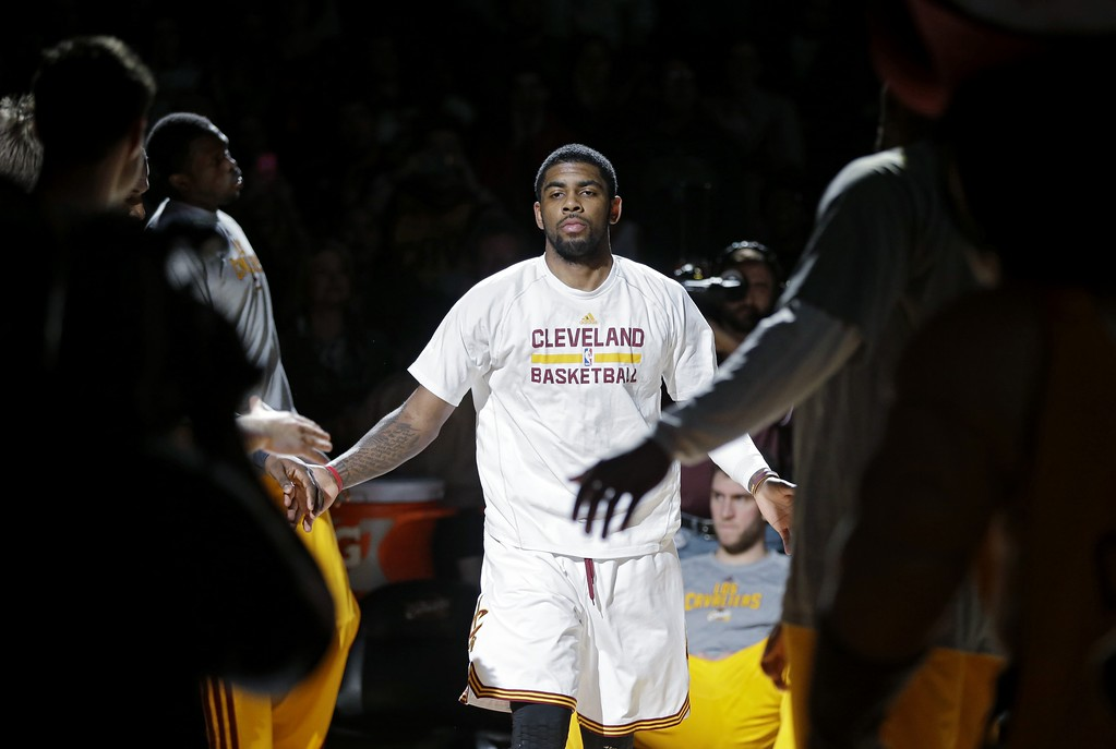 . Cleveland Cavaliers\' Kyrie Irving is introduced before an NBA basketball game against the San Antonio Spurs Tuesday, March 4, 2014, in Cleveland. (AP Photo/Mark Duncan)