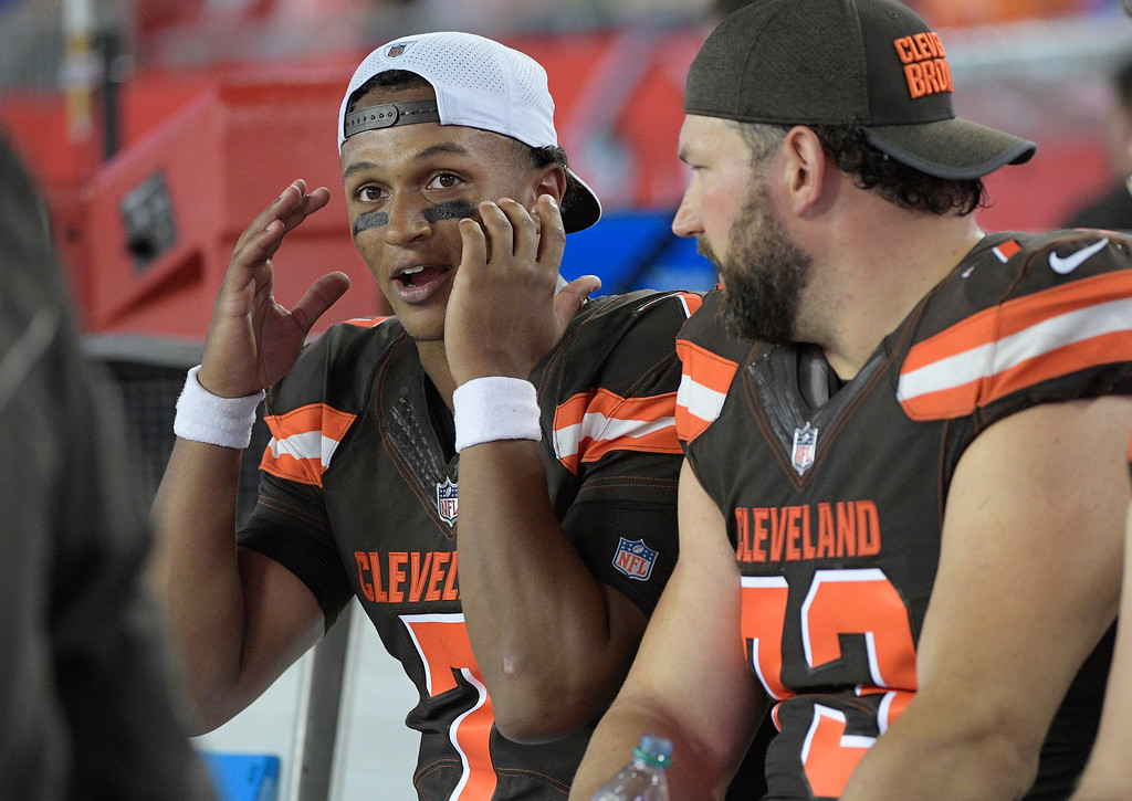 . Cleveland Browns quarterback DeShone Kizer (7) talks to tackle Joe Thomas during the third quarter of an NFL preseason football game against the Tampa Bay Buccaneers Saturday, Aug. 26, 2017, in Tampa, Fla. (AP Photo/Phelan Ebenhack)