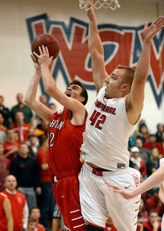 . Brighton\'s Jedidiah Grein (22) gets fouled by Chaparral\'s Mitch Parsons (42) during the fourth quarter February 27, 2013. Chaparral defeated Brighton 59-47. (Photo By John Leyba/The Denver Post)