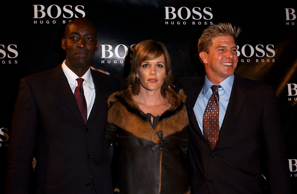 . Castmates Michael Jace, Catherine Dent and Kenneth Johnson  arrive at the grand re-opening party of the Hugo Boss Rodeo store on September 4, 2003 in Beverly Hills, California.  (Photo by Amanda Edwards/Getty Images)