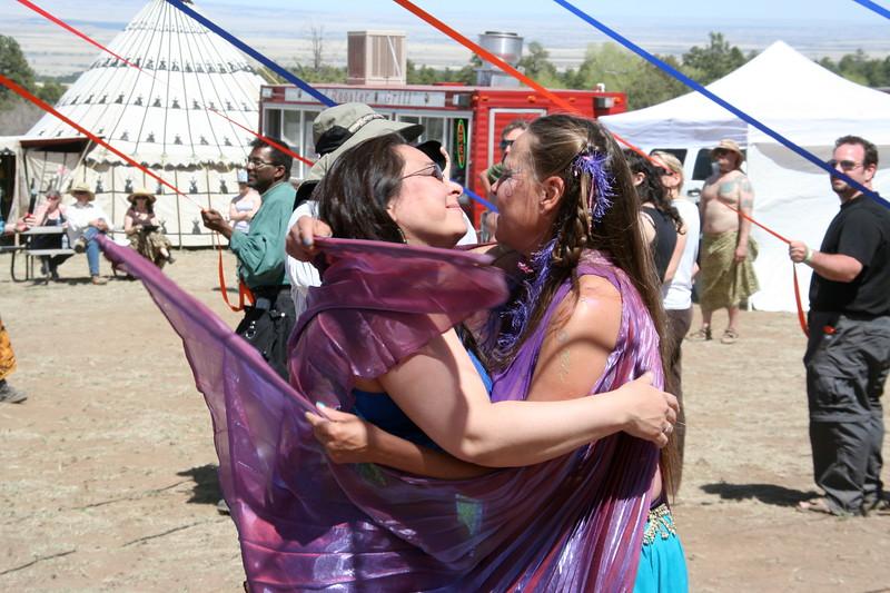 Dancers embrace