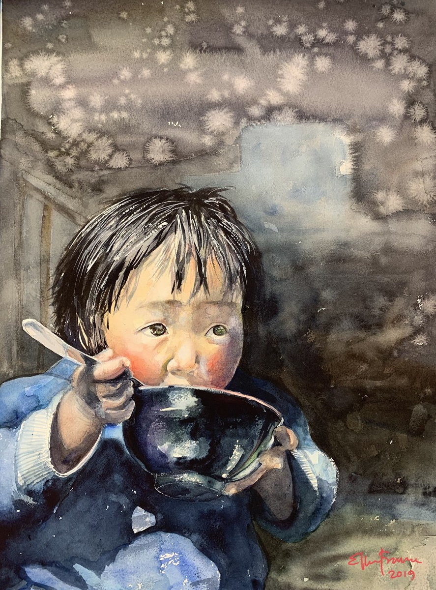Child eating from a rice bowl.