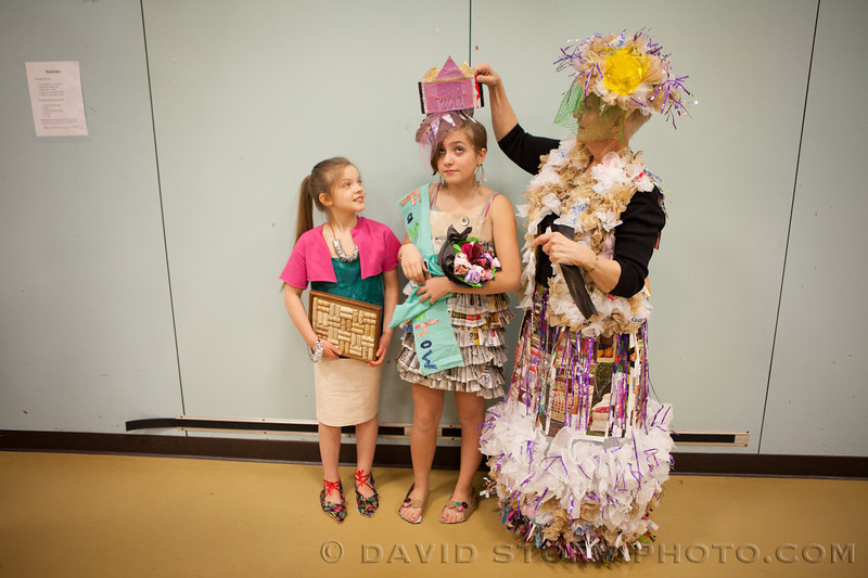 Theresa Norris adjusts Clara LaRock's crown at the Cooper Landing recycled fashion show.