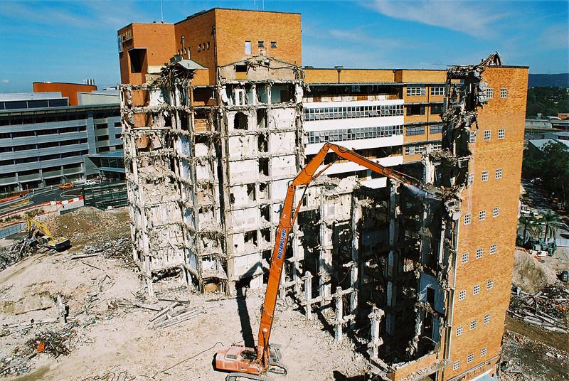 Demolition of the Princess Alexander hospital in Brisbane, showing a Hitachi EX700 high reach excavator