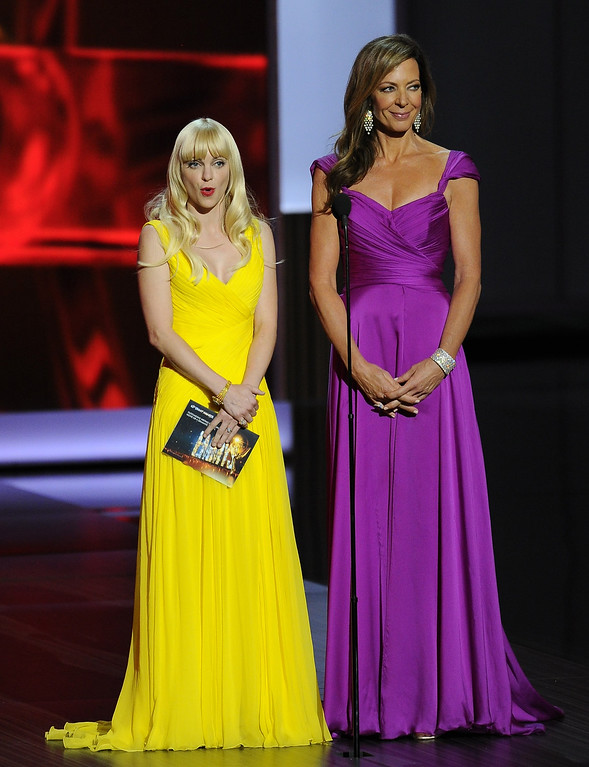 . Anna Faris, wearing Monique Lhuiller, left, and Allison Janney, wearing David Meister Signature, present the award for outstanding writing for a miniseries, movie or a dramatic special at the 65th Primetime Emmy Awards at Nokia Theatre on Sunday Sept. 22, 2013, in Los Angeles.  (Photo by Chris Pizzello/Invision/AP)