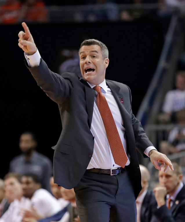 . Virginia coach Tony Bennett gestures during the first half of the team\'s first-round game against UMBC in the NCAA men\'s college basketball tournament in Charlotte, N.C., Friday, March 16, 2018. (AP Photo/Gerry Broome)