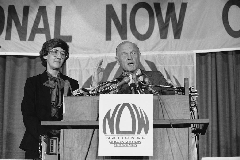 ". Sen. John Glenn, D-Ohio, gestures during his address to the National Organization for Women\'s annual conference in Washington, Sunday, Oct. 2, 1983 as the group\'s President Judy Goldsmith listens. After his speech, Glenn drew boos and hisses from the women for saying ""I think we all loafedon the ERA, We didn\'t work hard enough. The opposition outworked and out hustled us.\"" (AP Photo/J. Scott Applewhite)"