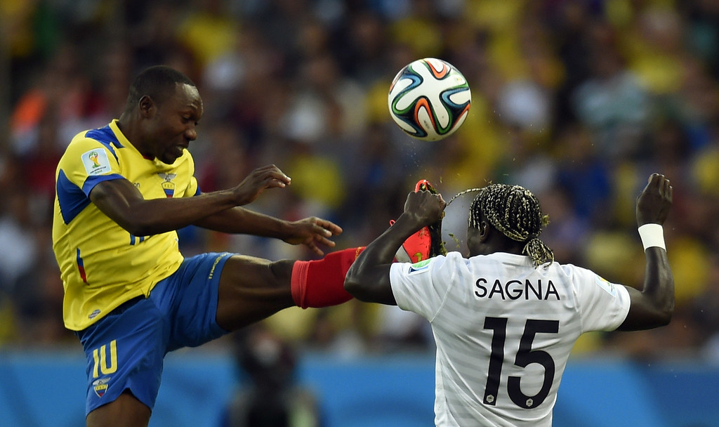 . France\'s defender Bacary Sagna (R) and Ecuador\'s midfielder Walter Ayovi vie for the ball during the Group E football match between Ecuador and France at the Maracana Stadium in Rio de Janeiro during the 2014 FIFA World Cup on June 25, 2014. ODD ANDERSEN/AFP/Getty Images