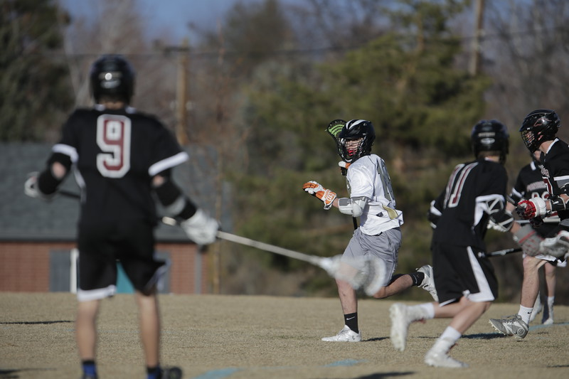 JPM0079-JPM0079-Jonathan first HS lacrosse game March 9th.jpg