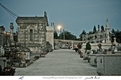 Full summer moon hanging over a cemetery in Aquitaine, France.