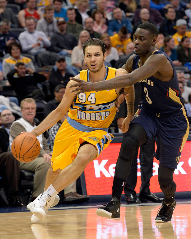 . Denver Nuggets guard Evan Fournier (94) drives past New Orleans Pelicans guard Anthony Morrow (3) during the fourth quarter April 2, 2014 at the Pepsi Center in Denver. The Denver Nuggets defeated the New Orleans Pelicans 137-107. (Photo by John Leyba/The Denver Post)