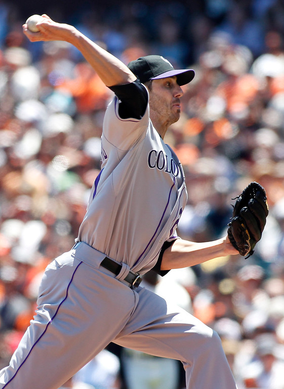 . Colorado Rockies pitcher Jon Garland throws to the San Francisco Giants during the first inning of a baseball game on Sunday, May 26, 2013, in San Francisco. (AP Photo/George Nikitin)