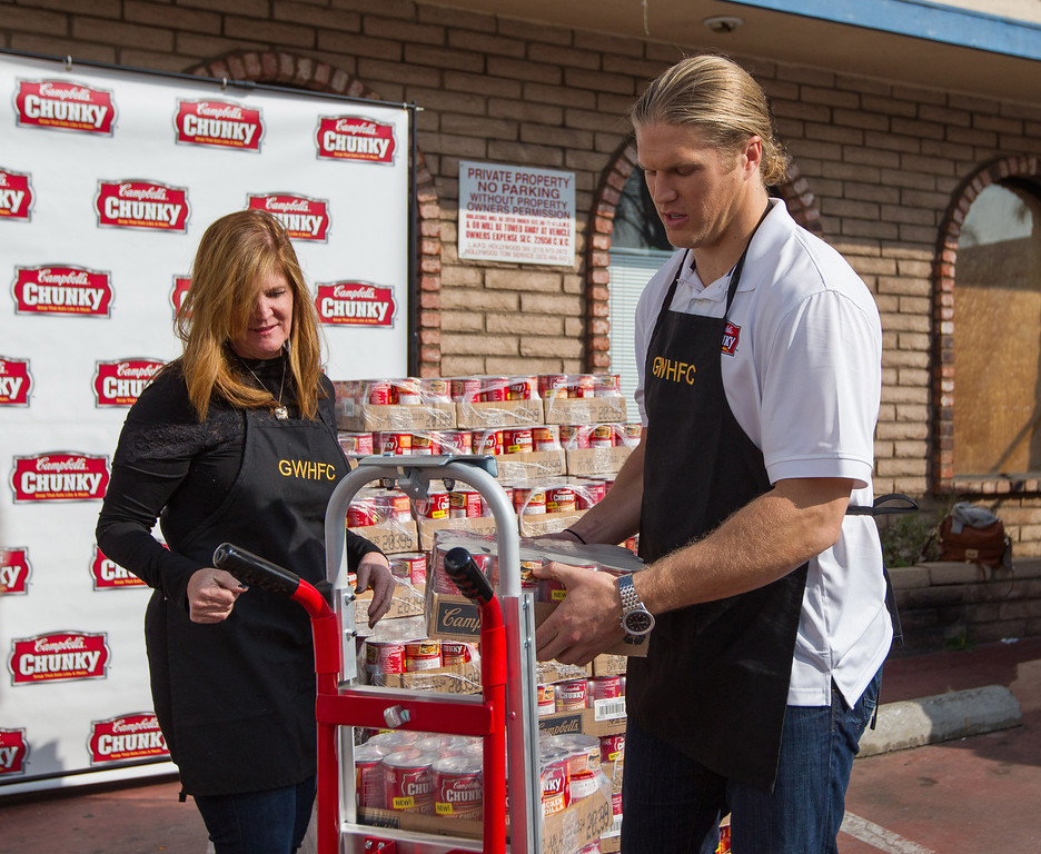 . Campbell�s Chunky Soup Mama�s Boy, Clay Matthews helps food bank staffers to unload his soup donation at the Greater West Hollywood Food Coalition as a part of his Sacks for Soup campaign on Tuesday, Feb. 23, 2014 in Los Angeles.  Matthews and Campbell�s Chunky donated 40,000 cans of soup to food banks around the country during this past NFL season as a result of the Sacks for Soup program. (Photo by Jeff Lewis)