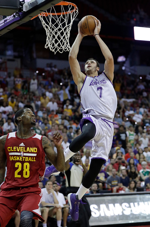 . Los Angeles Lakers\' Larry Nance Jr. dunks over Cleveland Cavaliers\' DeAndre Liggins during the first half of an NBA summer league basketball game, Thursday, July 14, 2016, in Las Vegas. (AP Photo/John Locher)