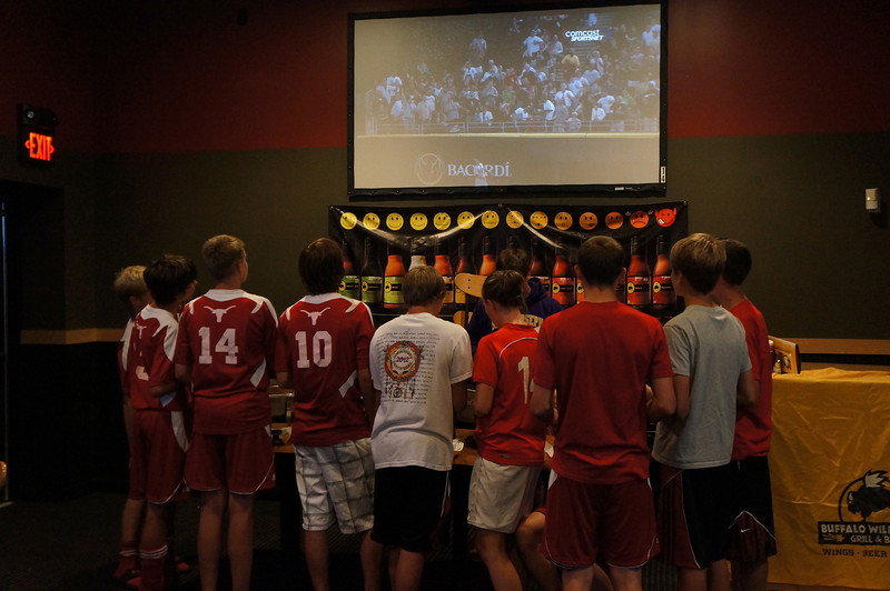 Soccer players waiting for more food at Buffalo Wild Wings afte the 10th Annual Alumni Soccer Game at Lutheran West.