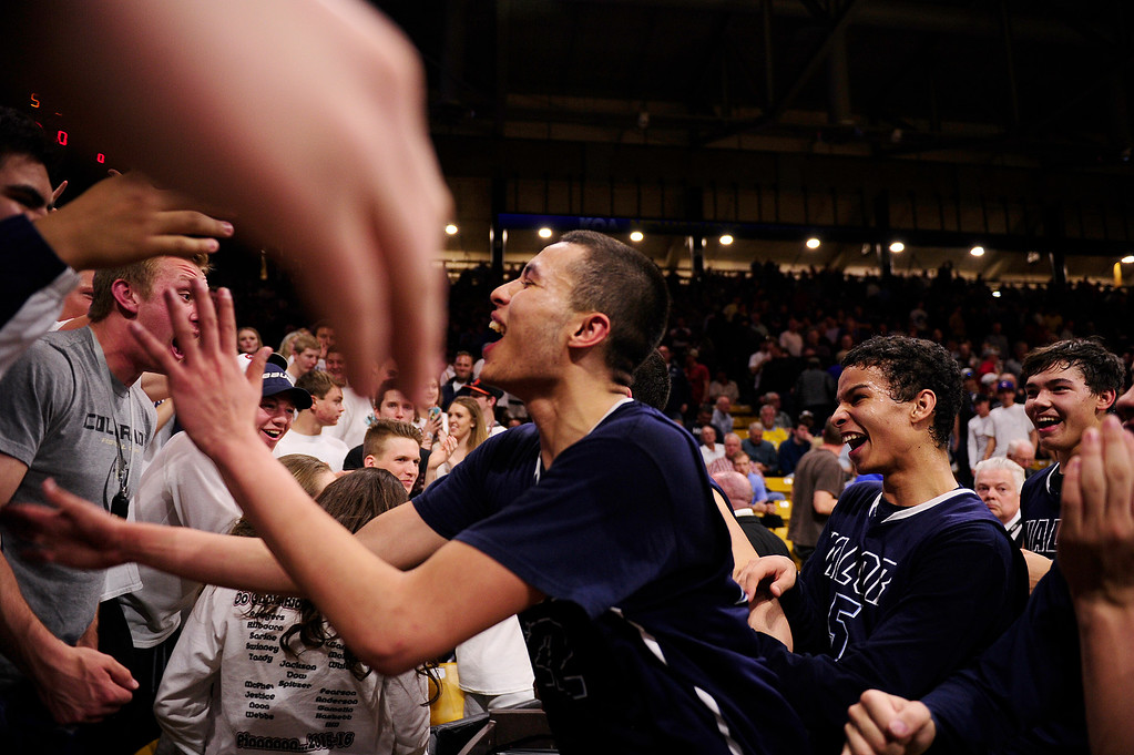 . Jalen Sanders (22) of Valor Christian celebrates with the crowd after defeating Longmont at the Coors Events Center on March 11, 2016 in Boulder, Colorado. Valor Christian defeated Longmont 58-53 to advance to the 4A finals of Colorado state basketball tournament.  (Photo by Brent Lewis/The Denver Post)