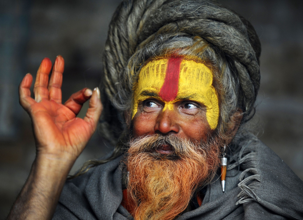 . A Hindu Sadhu (holy man) poses for a photograph during the Maha Shivaratri festival at the Pashupatinath temple in Kathmandu on February 27, 2014. Hindus mark the Maha Shivratri festival by offering special prayers and fasting. Hundreds of sadhus have arrived in Pashupatinath to take part in the Maha Shivaratri festival. AFP PHOTO/Prakash  MATHEMA/AFP/Getty Images