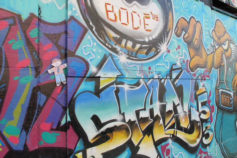 Flat Stanley finds his name, Stan, in the graffiti