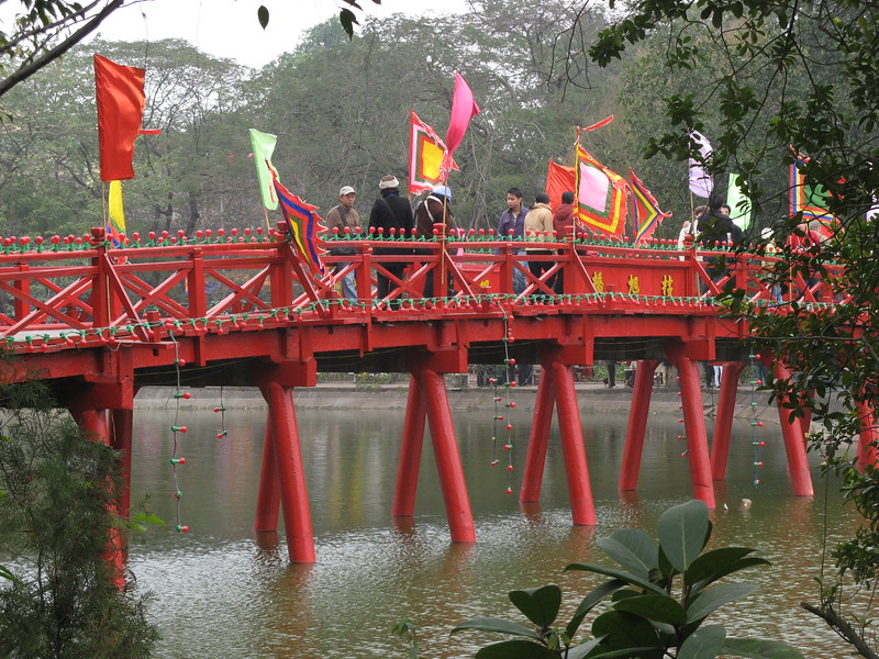 Crowds crossing the bridge on Hoan Kiem Lake, Hanoi. It was TET (Chinese Lunar New Year).