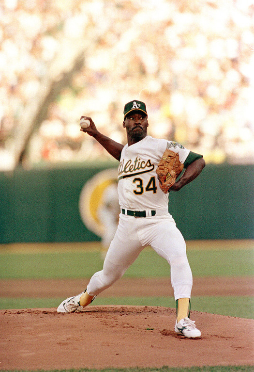 . Oakland Athletic\'s Dave Stewart pitches against the Los Angeles Dodgers in the first inning of game four of the World Series at Oakland Coliseum, October 19, 1988. (AP Photo/Lennox McLendon)