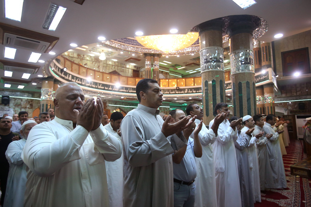 . Iraqi Shia Muslims attend prayers on the first day of Eid al-Adha at the mosque in Baghdad, Iraq, Monday, Sept. 12, 2016. Muslims around the world celebrated Eid al-Adha Monday to commemorate the willingness of the Prophet Ibrahim - or Abraham as he is known in the Bible - to sacrifice his son in accordance with God\'s will, though in the end God provides him a sheep to sacrifice instead. (AP Photo/Karim Kadim)