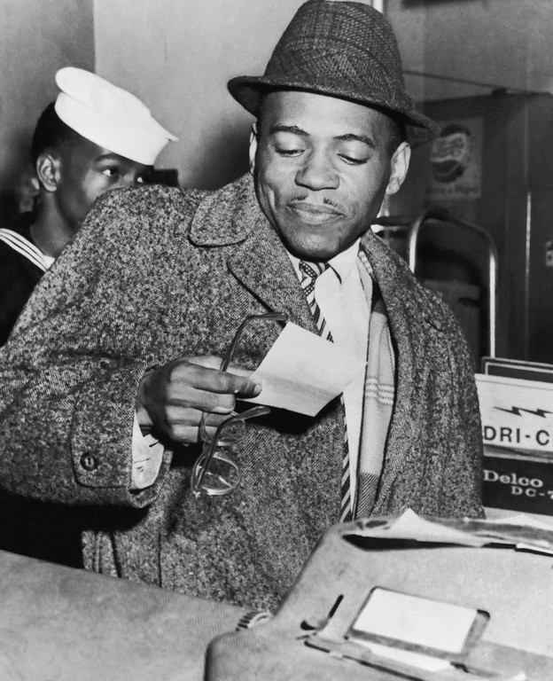 . James H. Meredith prepares to pay for repairs to his automobile at a Memphis service station on Jan. 23, 1963. Battery trouble caused Meredith to come to Memphis for repairs after he finished semester examinations at the University of Mississippi where he was the first African American knowingly admitted. (AP Photo)