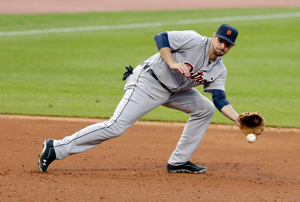 . Detroit Tigers\' Nick Castellanos fields a ball hit by Cleveland Indians\' Asdrubal Cabrera in the third inning of a baseball game, Monday, May 19, 2014, in Cleveland. Cabrera was out at first base. (AP Photo/Tony Dejak)