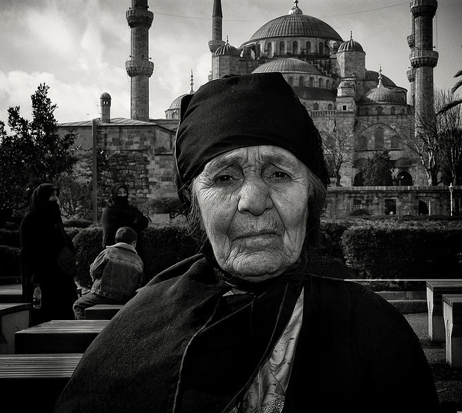 Portrait of a woman in front of the Sultan Ahmed Mosque. 