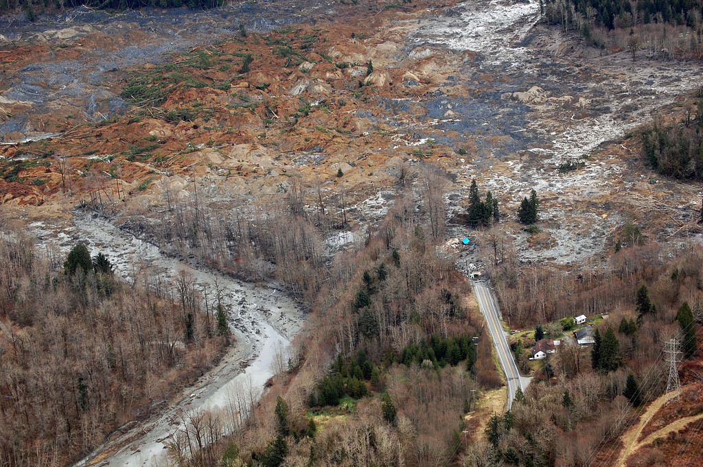 . This March 22, 2014 photo, made available by the Washington State Dept of Transportation shows a view of the damage from Saturday\'s mudslide in Oso, Wash.(AP Photo/Washington State Dept of Transportation)