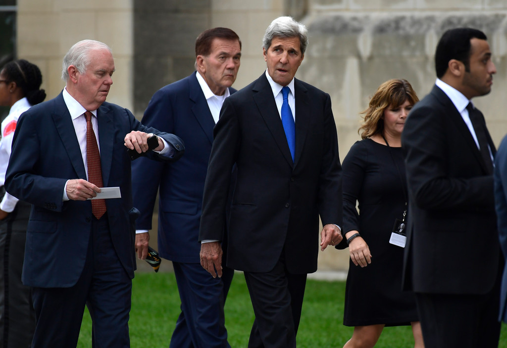 . Former Secretary of State John Kerry, center, and former Homeland Security Secretary Tom Ridge, second from left, arrive to attend a memorial service for Sen. John McCain, R-Ariz., at the Washington National Cathedral in Washington, Saturday, Sept. 1, 2018. McCain died Aug. 25 from brain cancer at age 81. (AP Photo/Susan Walsh)
