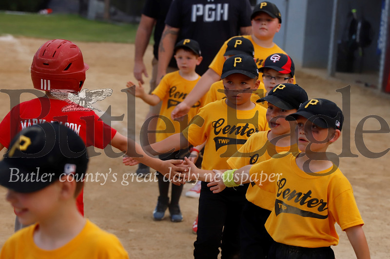 The Center Township 5-8 year-old Pirates line up for post-game high fives with the Angels Tuesday July 2. Seb Foltz/Butler Eagle