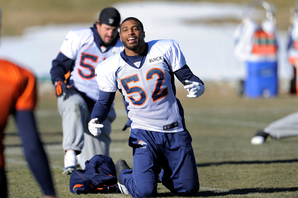 . Denver Broncos outside linebacker Wesley Woodyard (52) stretches during practice Thursday, January 3, 2013 at Dove Valley.  John Leyba, The Denver Post