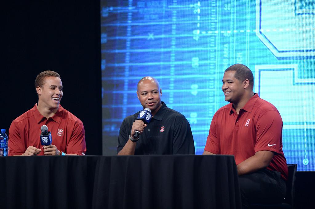 . STANFORD. Coach David Shaw, Shayne Skov (LB), left, and David Yankey (OL), right. Pac12 Media Day at Sony Studios, Los Angeles  Photo by Brad Graverson 7-26-13