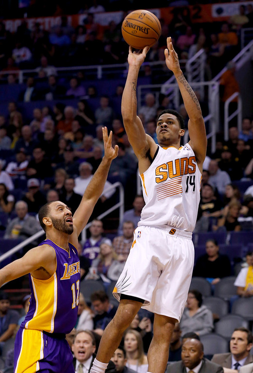 . Phoenix Suns\' Gerald Green (14) shoots a jumper over Los Angeles Lakers\' Kendall Marshall (12) during the second half of an NBA basketball game Wednesday, Jan. 15, 2014, in Phoenix. The Suns defeated the Lakers 121-114. (AP Photo/Ross D. Franklin)