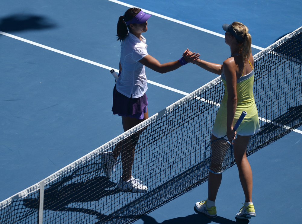 . China\'s Li Na (L) shakes hands with Russia\'s Maria Sharapova after her victory during their women\'s singles semi-final match on day 11 of the Australian Open tennis tournament in Melbourne on January 24, 2013.  PETER PARKS/AFP/Getty Images