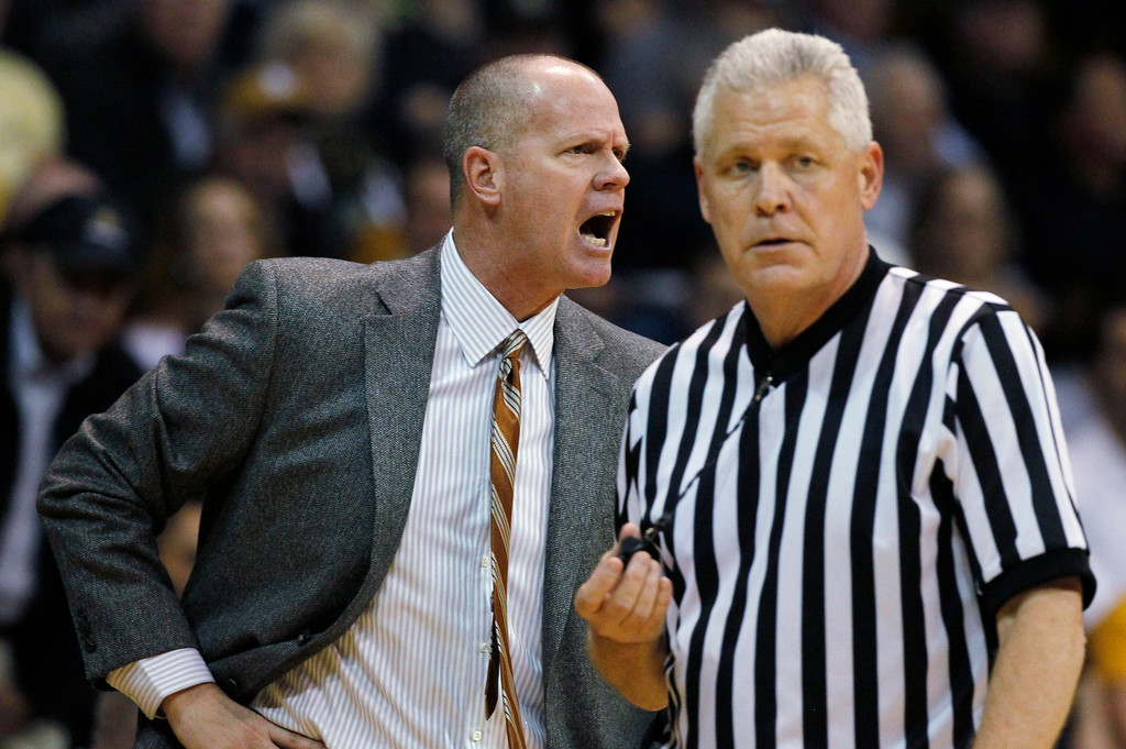 . Colorado coach Tad Boyle yells at referees after a call against his team during the first half of an NCAA college basketball game against California in Boulder, Colo., on Sunday, Jan. 27, 2013. (AP Photo/David Zalubowski)