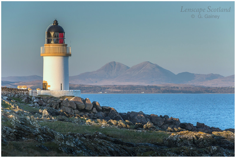 Port Charlotte lighthouse and the Paps of Jura