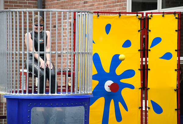 6/1/2018 Mike Orazzi | Staff Bristol Eastern Principal Marisa Calvi-Rogers waits to be dunked during the SAT fair for juniors on Friday in the school's courtyard.