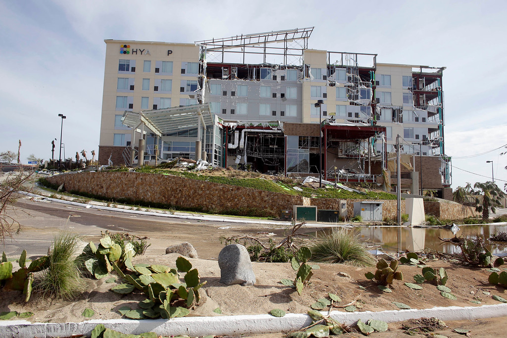 . View of a Hyatt hotel destroyed by Hurricane Odile in Los Cabos, Mexico,  Tuesday, Sept. 16, 2014.  Desperate locals and tourists were still in survival mode on Wednesday  in the resort area of Los Cabos, with electrical and water service still out three days after Hurricane Odile made landfall as a monster Category 3 storm.(AP Photo/Victor R. Caivano)