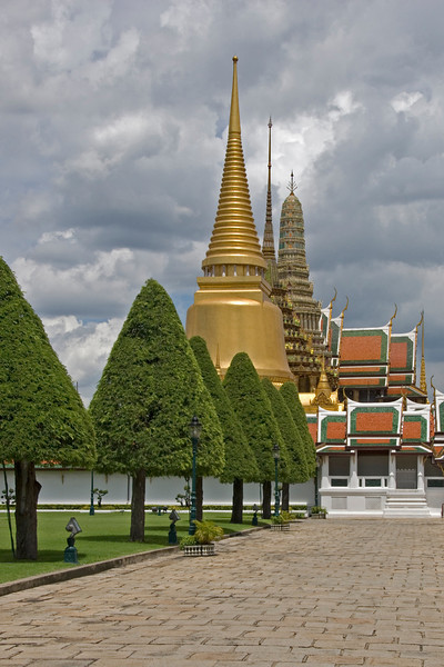 Stupas and landscaped trees in Wat Phra Kaew - Bangkok, Thailand