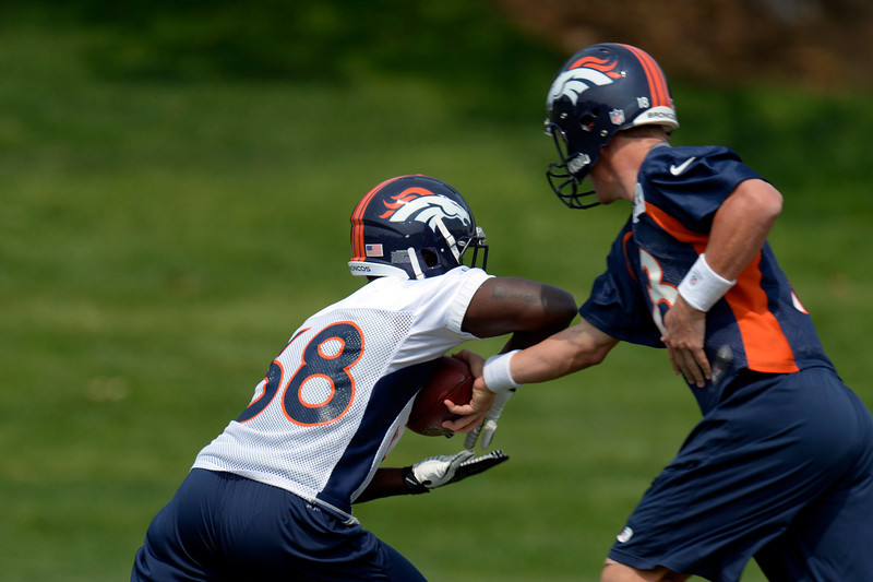 . Peyton Manning (18) QB of the Denver Broncos hands off to Montee Ball (38) during drills on the last day of  minicamp June 13, 2013 at Dove Valley. (Photo By John Leyba/The Denver Post)