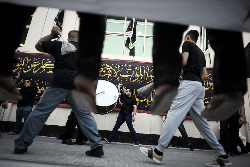 . Bahraini Shiite Muslims take part in a ritual of self-flagellation during a religious procession marking Ashura, which commemorates the seventh century slaying of Imam Hussein, the grandson of Prophet Mohammed, in the village of Sanabis, west of Manama on November 1, 2014. MOHAMMED AL-SHAIKH/AFP/Getty Images