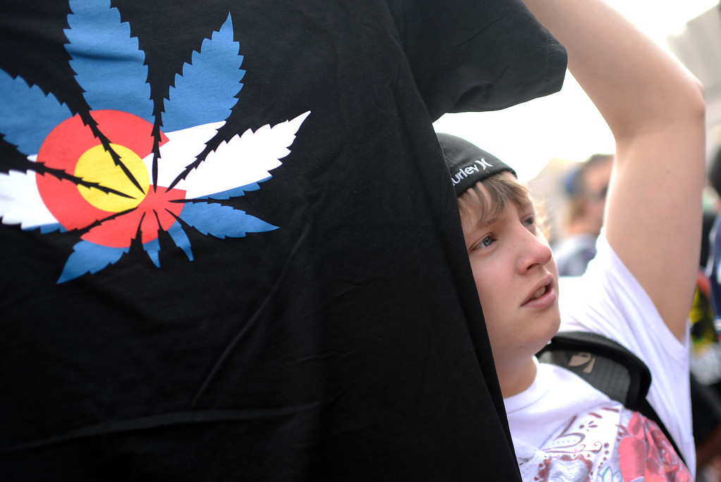 . DENVER, CO. - APRIL 20 : John Condon of Denver is selling the t-shirts at Civic Center park in Denver. A crowd of marijuana smokers gathered at the Park of Denver to mark the counterculture holiday known as 4/20 on the first celebration since Colorado and Washington made pot legal for recreation use. (Photo By Hyoung Chang/The Denver Post)